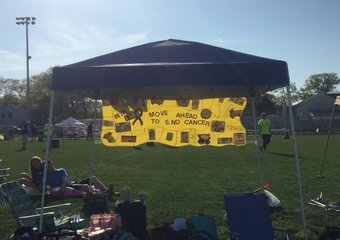 MMS banner and campsite